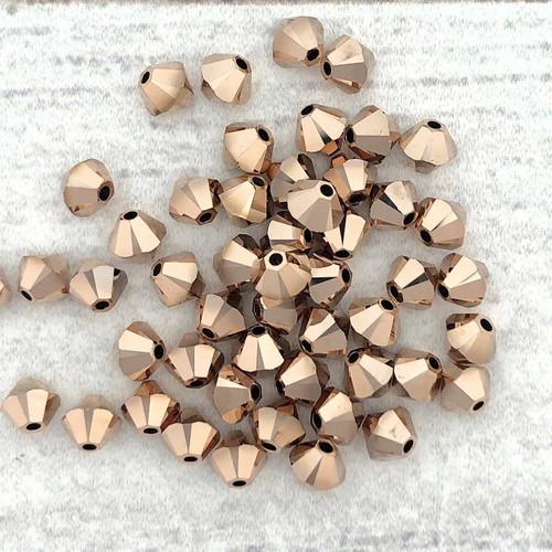 4mm Swarovski Bicones, Crystal Rose Gold 2X (Qty: 50)