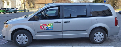 A thick magnet that can be placed on vehicle doors to add corporate branding.