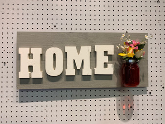 Vertical home sign with vase