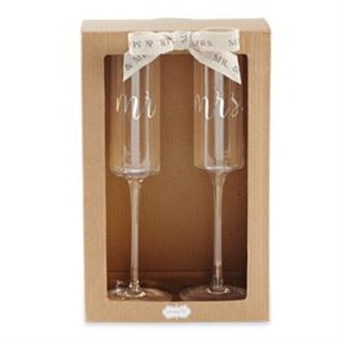 "Set of two champagne glasses feature foiled ""mr."" and ""mrs."" sentiments and arrive gift boxed."