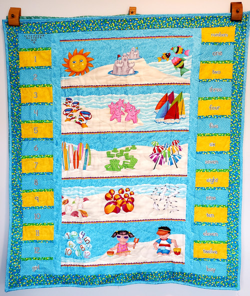 A view of the front of the Fun Day at the Beach Toddler Quilt