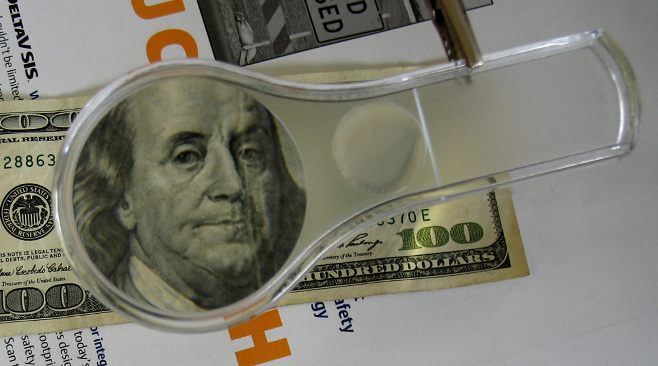 Magnifier used to inspect money