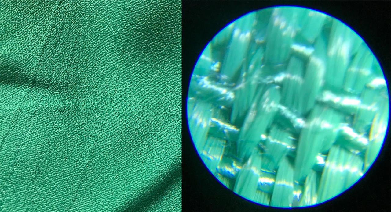 Green fabric under Pocket Microscope Zoom 60X - 100X with white LED light