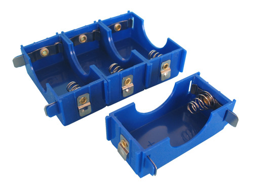 Linkable 1-D battery holders available in blue or yellow colors