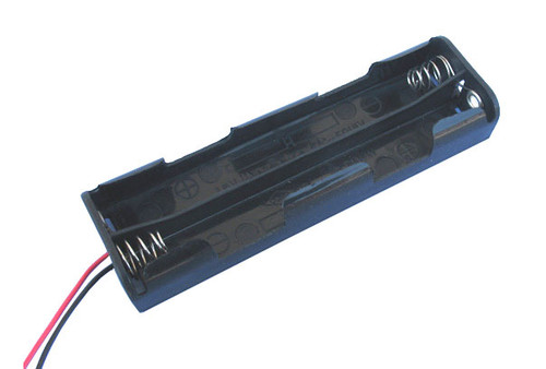 Battery holder accepting 4 AA size batteries providing 6 volts output with connection wires