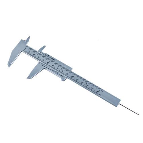 Vernier caliper, dual scale, made of hard plastic, measures width,  openings and depth.
