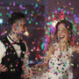 wedding couple celebrate their wedding with multi color 12 inch handheld confetti cannons