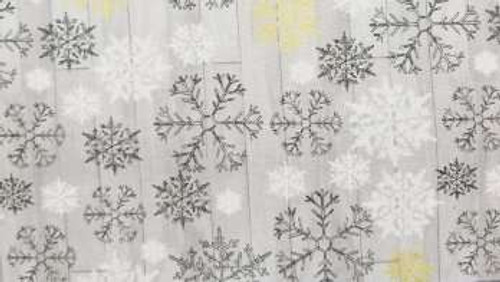 Gold, Grey, and White Snowflakes on Grey Wood Plank