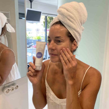 Balance Me co-Founder Clare applying Pure Skin Face Wash 125ml to her face