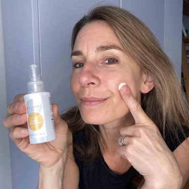 Balance Me Co-Founder Rebecca applying Vitamin C Repair Serum to her face