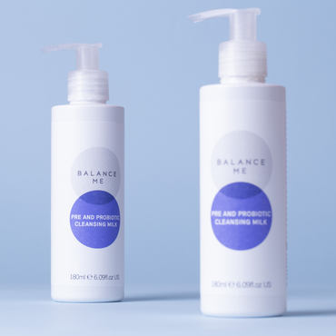 Two bottles of Balance Me Pre and Probiotic Cleansing Milk 180ml - one in focus, the other out of focus