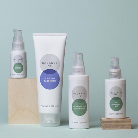 Balance Me Clearer Skin Kit (4 products) on a duck egg blue background