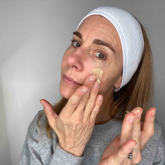 Balance Me Co-Founder Rebecca applying Balance Me Cleanse and Smooth Face Balm  to her face