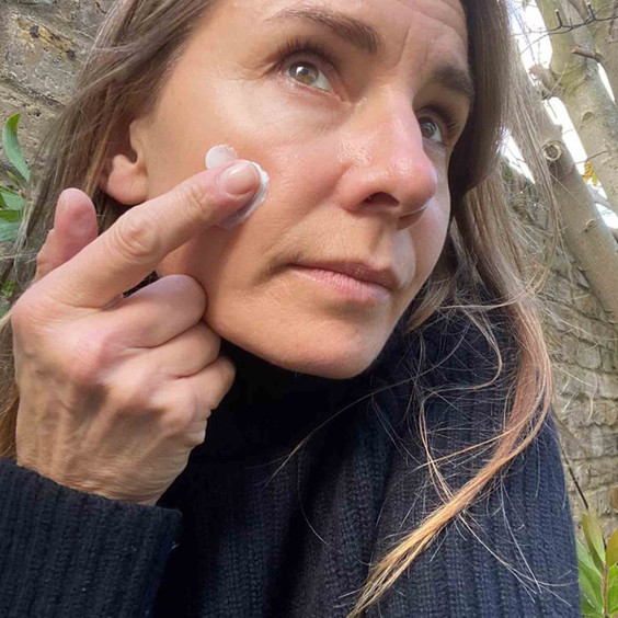 Balance Me Co-Founder Rebecca applying Moisture Rich Face Cream 50ml for her face to show the texture
