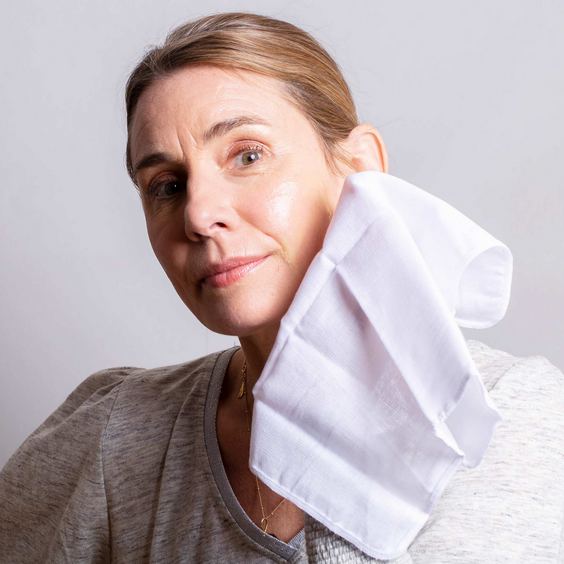 Balance Me Co-Founder using the Muslin Cloth on her face