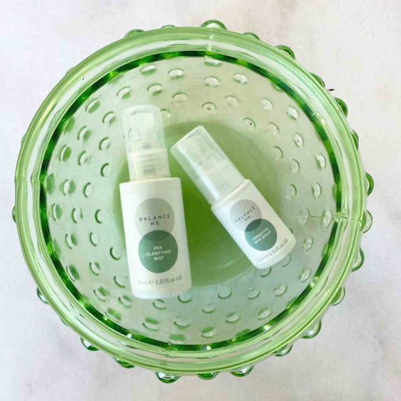 Perfect Partner duo products Balance Me Congested Skin Serum and PHA Clarifying Mist in a green glass dish