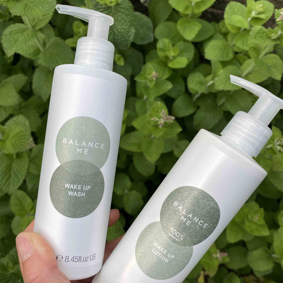 Perfect Partners; Wake Up Lotion 250ml and Wake Up Wash 250ml being held to camera
