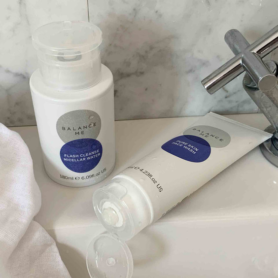 Complementary products Balance Me Flash Cleanse Micellar Water and Pure Skin Face Wash on a bathroom shelf