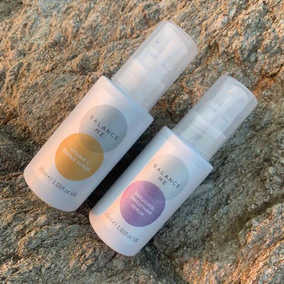 Balance Me Day + Night bundle (2 products) laying on a beach rock