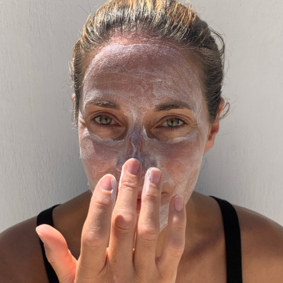 Balance Me Co-Founder Clare applying Balance Me AHA Glow Mask to her face