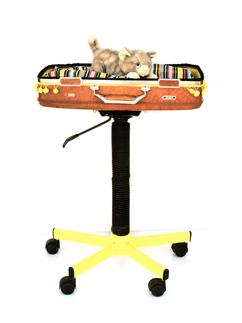 Brown and yellow suitcase cat bed on swivel stand