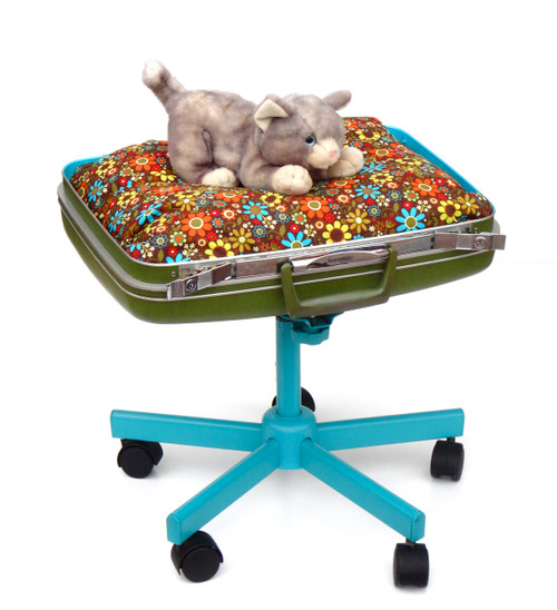 Green suitcase cat bed with turquoise rolling stand
