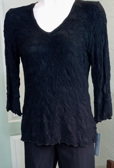 SnoSkins Black V-Neck Top at Bijou's Boutique. Three-quarter length sleeve.   Scalloped hemline. 91% Viscose/5% Nylon/4% Elastane.  Made in the USA