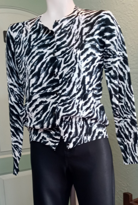 Ava Paige Cardigan - Zebra print at Bijou's Boutique. Long sleeve, waist length that   can be worn as a Cardigan or Top. 70% Rayon/30% Nylon.