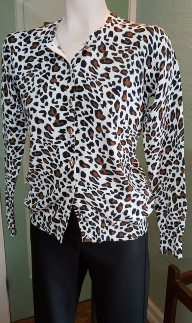 Ava Paige Cardigan - Leopard print at Bijou's Boutique. Long sleeve, waist length that  can be worn as a Cardigan or Top. 70% Rayon/30% Nylon
