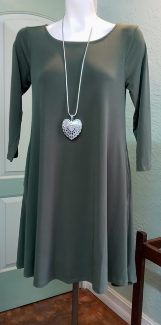 """Nina Leopard Olive Swing Dress at Bijou's Boutique. Three-quarter length sleeves with   side seam pockets. 95% Polyester/5% Spandex.  Size Small dress measures 35"""" from shoulder seam to hem."""