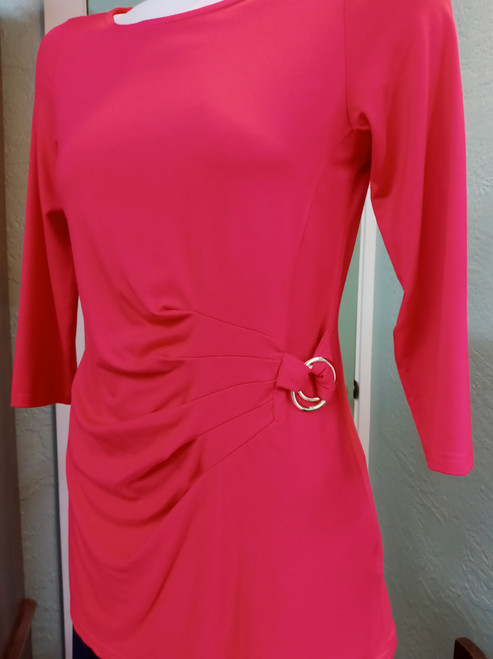 Michael Tyler Tangerine Tunic at Bijou's Boutique. Three-quarter length sleeve. Double   gold ring gather at left hip. 95% Polyester/5% Spandex.  Made in Canada.