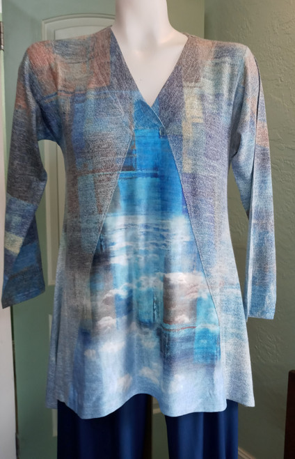 Cubism SwingTunic at Bijou's Boutique. Super soft tunic in beautiful and varied shades   of blue. Longer three-quarter length sleeve. 50% Rayon/46% Polyester/4% Spandex