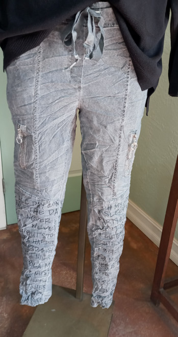 """Tempo Paris Drawstring Pant at Bijou's Boutique. Gray pant with decorative zipper  detail down side leg. Black """"writing"""" on each lower front leg. Elastic waist with  drawstring tie. Cotton/Spandex blend. Made in Italy."""
