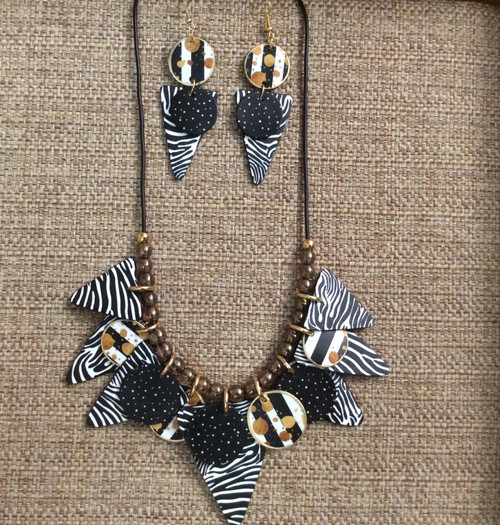 Hand crafted acrylic jewelry set with very light zebra patterns on both sides. Includes earrings and necklace at Bijou's Boutique