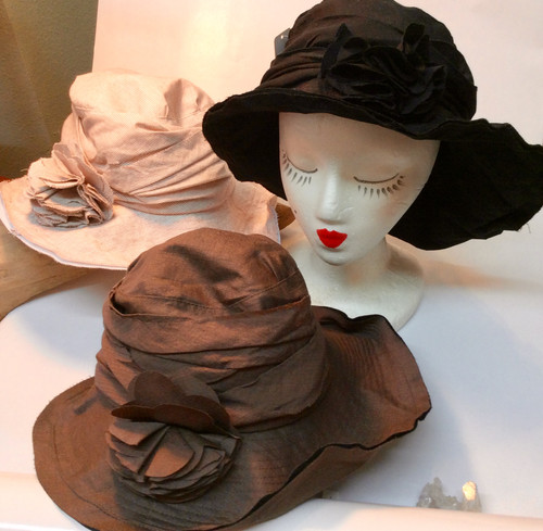 Jeanne Simmons Floppy Hat at Bijou's Boutique! The flower is a pin that can be removed. Crush it, pack it, can go to the beach or a wedding! Wear it to church or an art festival! It is a go-anywhere hat. Bijou keeps one in her car all the time.  Very light. 65% viscose/35% nylon.
