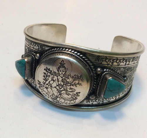 Tibet silver cuff with turquoise at Bijou's Boutique.
