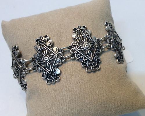 Diamond shaped sections zinc based bracelet at Bijou's Boutique.