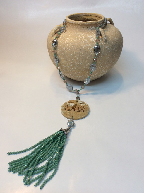 Carved stone and swarovski crystal necklace at Bijou's Boutique.