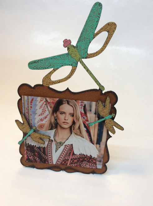 "6""x6"" cut metal and hand painted with dragonfly motif. 2 dragonfly magnets to hold your picture at Bijou's Boutique."