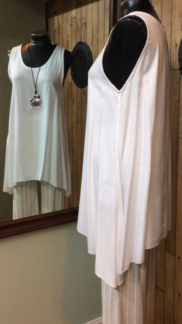 Iguana White A-line Tank at Bijou's Boutique. Beautiful, soft, easy to wear fabric. Great on its own for warm days and also great for layering. A must have in your closet! Loose fitting.