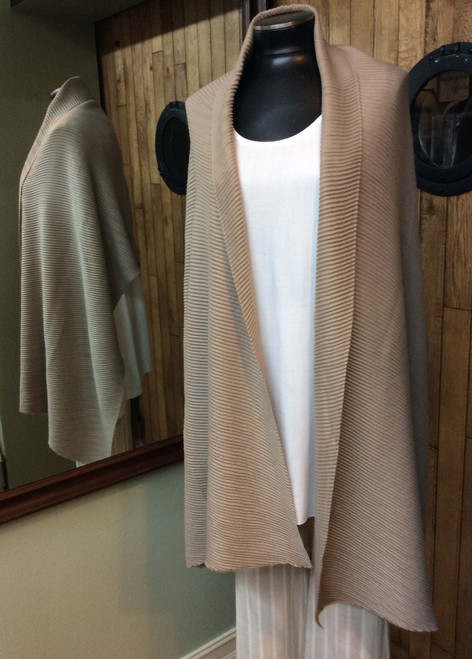 Khaki Wrap at Bijou's Boutique.  Perfect for any occasion.  Bijou always has one in her car for cold restaurants or just to put a soft wrap over her shoulders. Versitile color. 100% viscose.