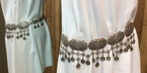 Belt is gorgeous imprint at Bijou's Boutique. Zinc based, nickel free metal. Non-corrosive metal, will not tarnish. Make a statement! This belt will look great over anything. Made in Turkey.