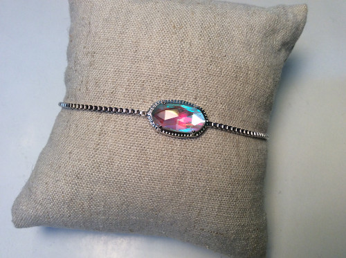 Adjustable bracelet from Covenant fashion with colorful crystal on silver at Bijou's Boutique.
