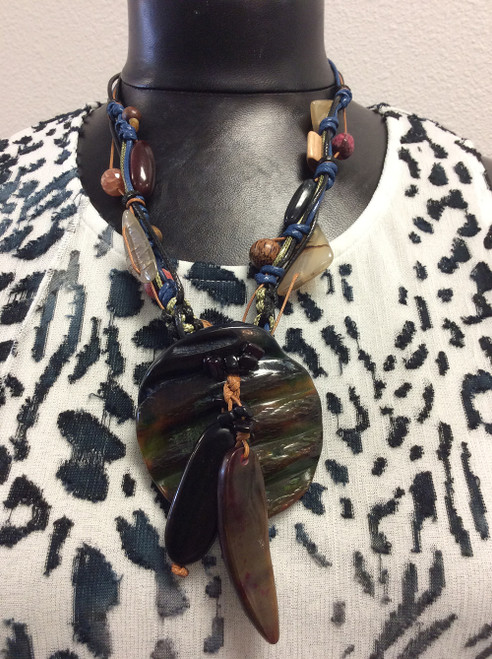 Alisha D. necklace made of bone, wood, stone, and leather at Bijou's Boutique.