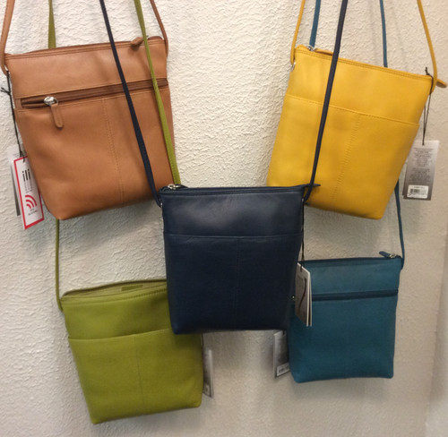 "Ili leather hand bags at Bijou's Boutique. RFID blocking. Long adjustable strap. 100% leather. Zipper closure. One pocket outside on each side of the bag, one zipper pocket inside. Big enough to fit what you need! Size 9""x9""."