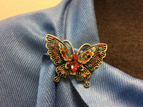 Magnetic buterfly multi color crystals brooch. No more holes in your clothes. Use it to keep scarves in place. Decorate your hat or your jackets.