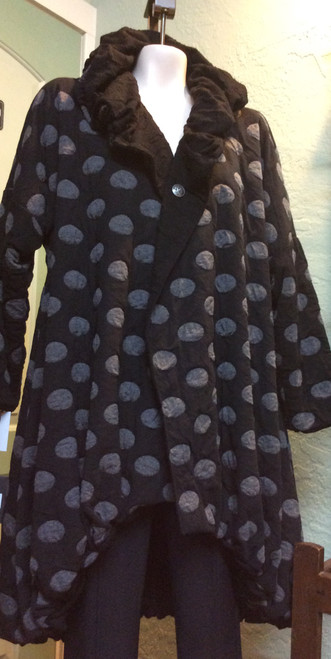 Ozai Black/Polka Dot Reversible Coat at Bijou's Boutique.  Reverses to patterned   plain black.  High-Lo hemline.  Shawl collar neckline with no button closure.   Beautiful coat on the heavier side.  83% Rayon/9% Polyester/8% Spandex. Extra shipping cost will apply to this item due to the heavier than normal weight of the garment.