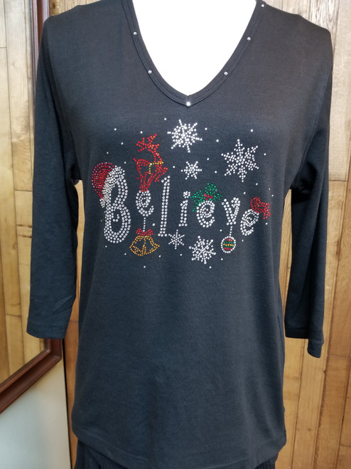 "Get Lucky Believe T-Shirt at Bijou's Boutique.  V-neck with 3/4 sleeve and  ""Bling"" Believe!  60% Combed Cotton/40% Polyester."