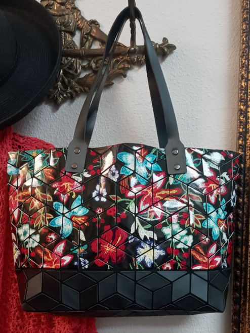 "Patrizia Luca Floral Tote at Bijou's Boutique.  Vegan Materials.    Geometric ""tile"" floral print with black background.  Blue interior lining.  Zipper closure."