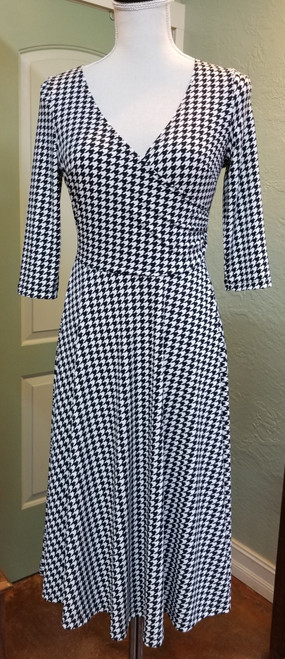 Mimozza Houndstooth Wrap Dress at Bijou's Boutique. Three quarter length sleeve with flare skirt.   95% Polyester/5% Spandex. Made in the USA.